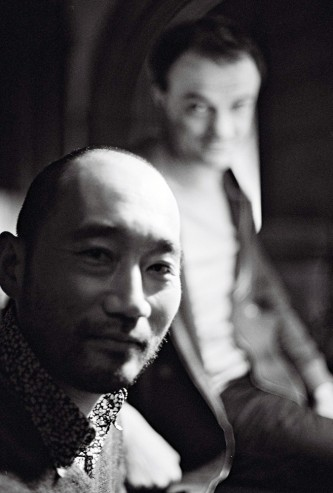 Toshi Nakamura and Jean-Luc Guionnet smile at the camera