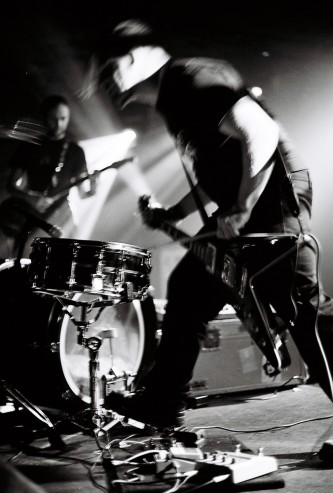 snare, bass drum & guitar framed by an aggressive posture
