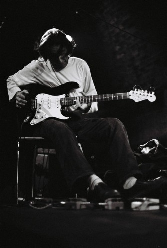 Loren Connors holding an electric guitar