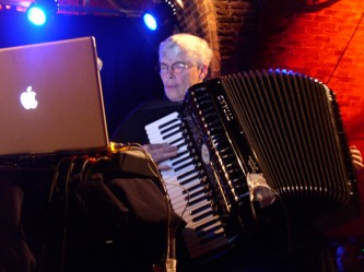Pauline Oliveros playing an accordion