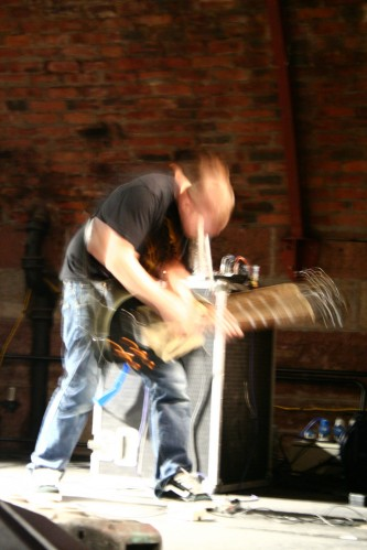 A guitarists movements blur the image