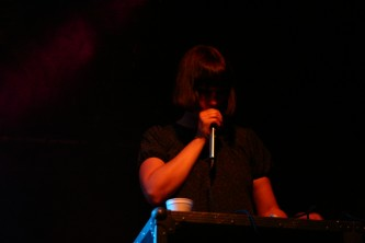 Karen Constance singing into a microphone