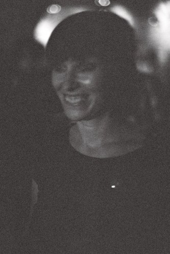A woman in the audience for Maryanne Amacher's performance, smiling