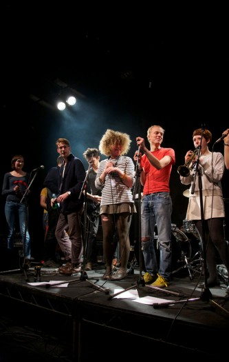 A large covers band comprising young people on stage