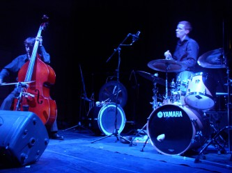 Richard Youngs playing a double bass Alex Neilson playing drums
