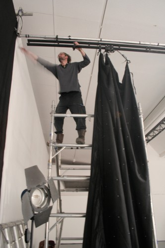A crew member starts to dismantle the set