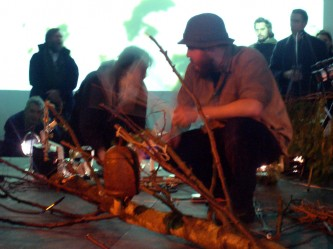 Thuja & Keith Evans on stage at KYTN among branches and projections