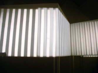 Stepped projection screen close up with vertical lines projected in patterns