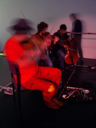 Tony conrad, angharad davies, nikos veliotis and mark wastel playing strings