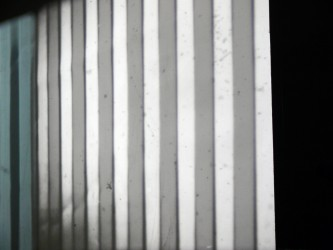 Close up of a screen with vertical lines in darker bands, the screen at an angle