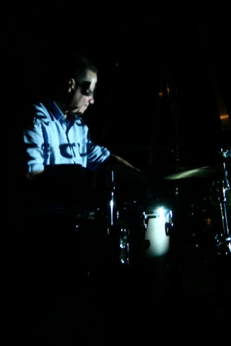 Mark Saunders playing drums in the dark