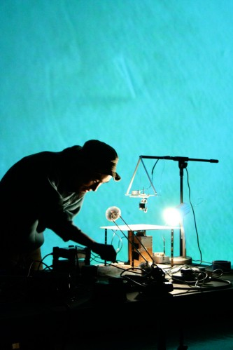 Kanta Horio operating an electro-magnet in front of a projection