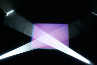 A rectangle of purple light with beams of white light in front
