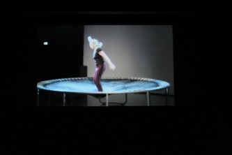 Shot of the projection of Aileen's performance in the same space