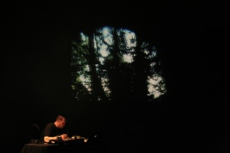 A projection of a tree near Lee Patterson who is working with a mixer
