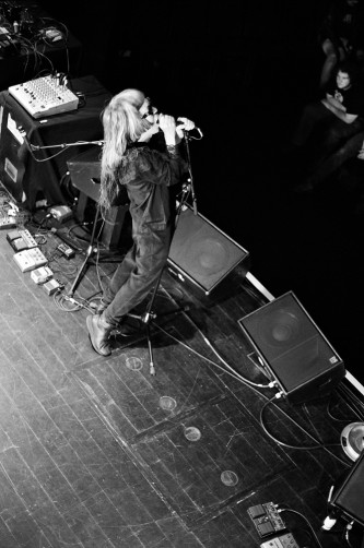 Keiji Haino singing into a microphone on stage at MLFC 05