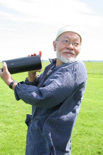 Akio Suzuki having a rest from blowing into a metal can on Orkney