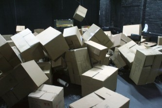 boxes and an amplifier in disarray