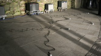 Amplifiers outside with mics on the floor coming from them