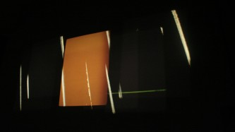 Projection of an orange rectangle along with shards of light