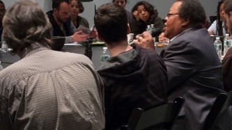 George Lewis talks to the gathered group, a close cropped shot