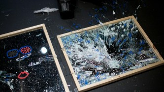 Two smashed mirrors with shards of glass here and there