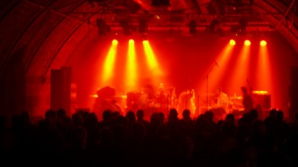 Vibracathedral Orchestra on stage in red light