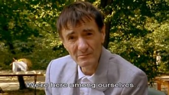 """A man in garden looks at the screen - """"We're here among ourselves…"""""""