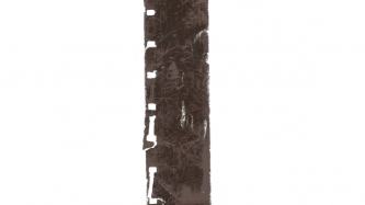 A section of exposed 16mm film stock covered in small abrasions