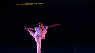 Dancer dressed in white, reaching, stretching back, legs and arms outstretched