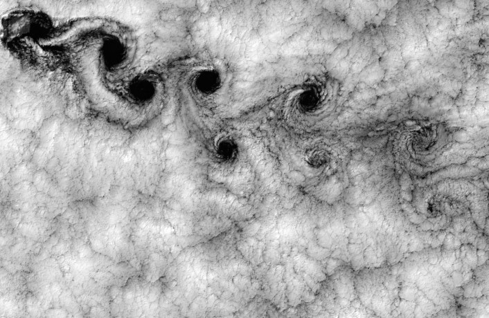 Black and white image of clouds from above showing a fractal pattern