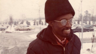 Julius Eastman wearing a hat and glasses