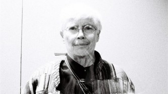 Pauline Oliveros backstage in black and white