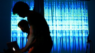 The user performing in front of a projection of digital images