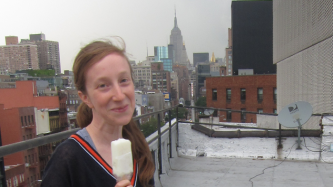 Amalle on a rooftop in NY holding an ice cream