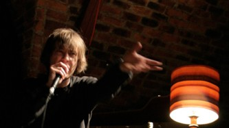Richard Youngs stamps his foot and points as he sings energetically