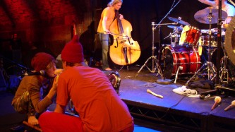 Rauhan Orkesteri performing on stage at INSTAL 05, bare feet, woolen hats