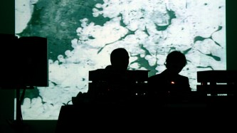 Mirror performing in front of a projection at KYTN 04