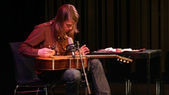 Topias Tiheäsalo fanning a guitar at MLFC 07
